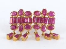 Ruby and yellow gold earrings.