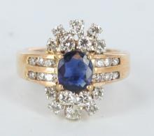 Sapphire, diamond, and yellow gold ladies ring.