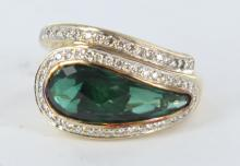 Thai green gemstone and diamond ladies ring.