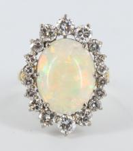 Opal cabochon and diamond ring.