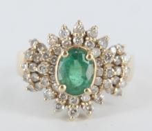 Ladies diamond and emerald ring.