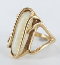 Opal and yellow gold ladies ring.