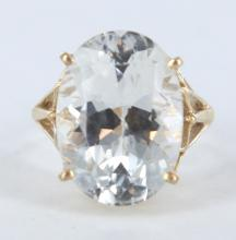 Synthetic white gemstone and yellow gold ring.