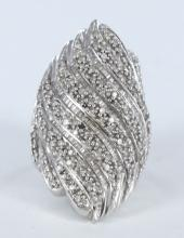 White gold cocktail ring encrusted with diamonds.