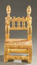 Baule gold leaf chair with male figures.