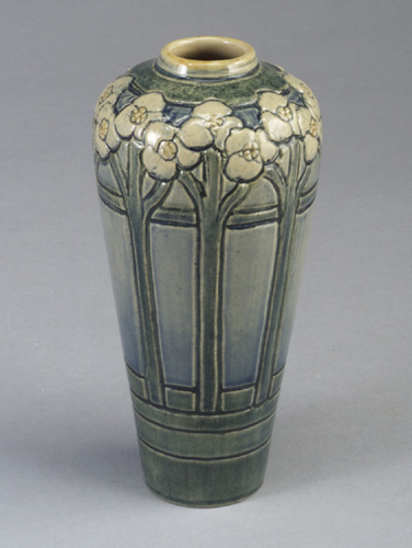 Fine and early NEWCOMB COLLEGE vase carved by Marie De Hoa LeBlanc with white and yellow