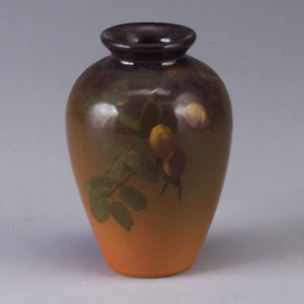 ROOKWOOD Standard Glaze vase by Howard Altman, 1903, painted with Rosehips. Firing flaw to rim. Flame mark/III/artist's initials. 5