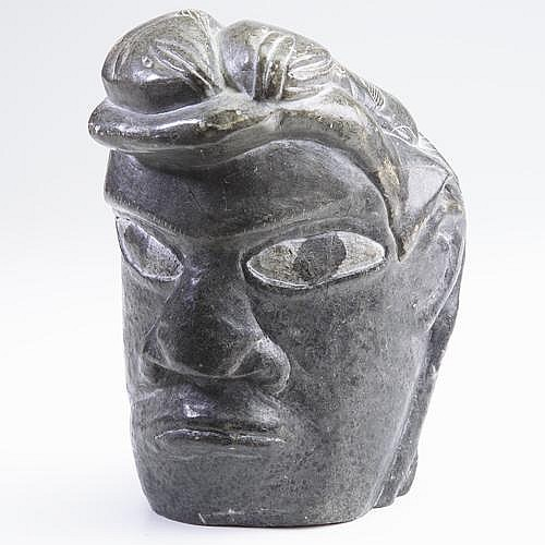 Jimmy Inaruli Arnamissak (Jimmy Smith) Inukjuak transformation carving of dark grey soapstone with man and fish. Marked,