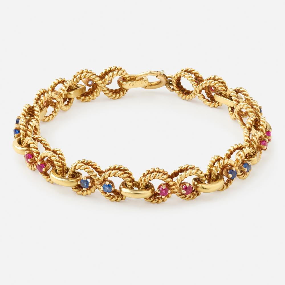 Cartier, Gold, sapphire, and ruby bracelet