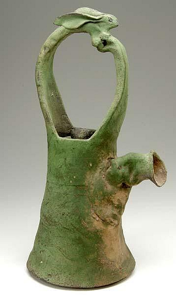 KEN FERGUSON Handbuilt, oversized stoneware teapot with rabbit-form handle covered in verdigris glaze. 23
