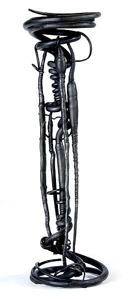 ALBERT PALEY Plant stand of forged and fabricated steel with circular slate top, 1982. Stamped PALEY 1982. 53