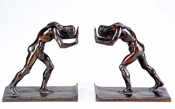 Isidore Konti (Austrian/American, 1862-1938) Pushing Athletes, 1909-12; Bronze bookends; Each signed