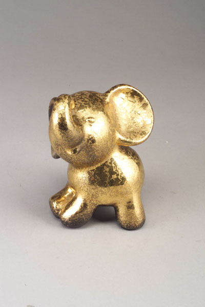 SASCHA BRASTOFF elephant figurine, 1958, covered in a textured gold glaze. Marked Sascha B/58. 8 1/4