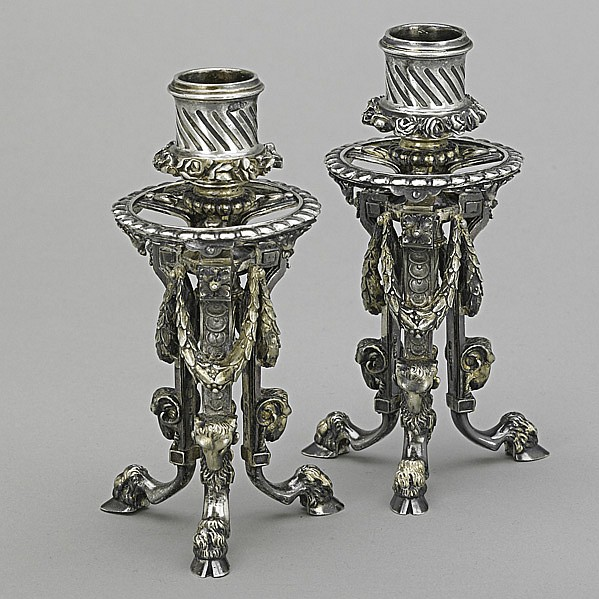PAIR PARCEL-GILT 88 SILVER CANDLE STANDS; Rams