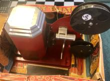Lot 2: 1942 EXCEL TIN LITHO JOLLY THEATER 16MM MOVIE PROJECTOR-IOB