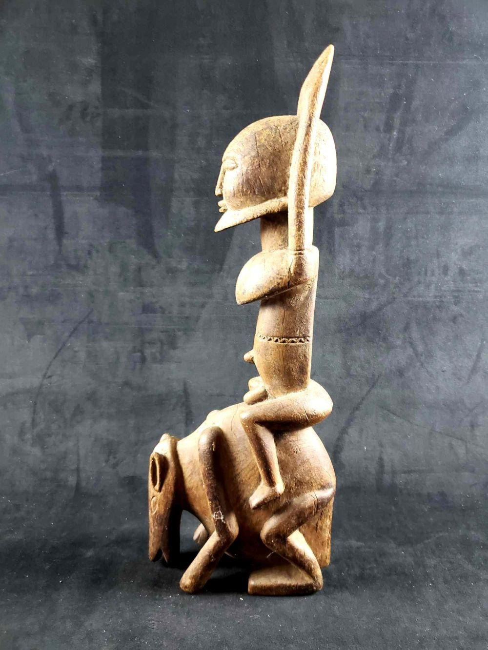 Hand Carved African Man Riding Anteater Sculpture