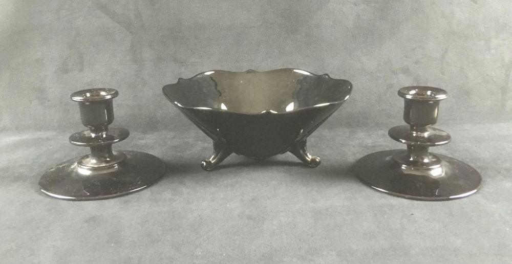 Lot 124: Black Glass 3 Footed Candy Dish and Two Candle Holders