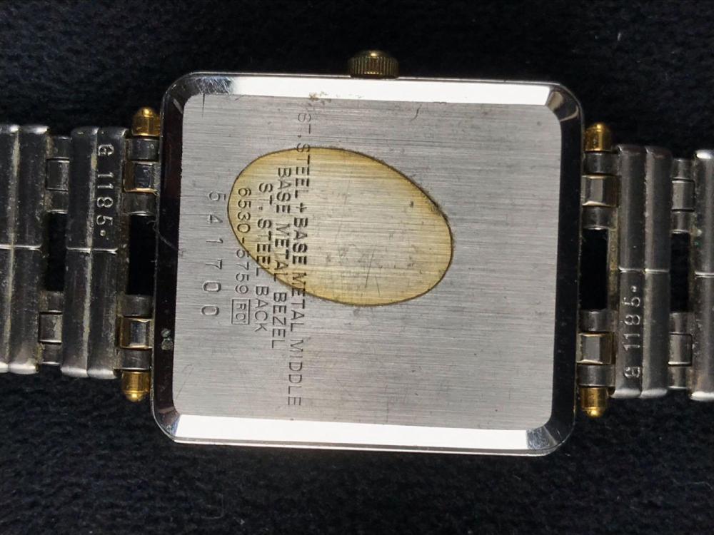 Lot 145: Seiko Quartz Silver and Gold Square Face Design