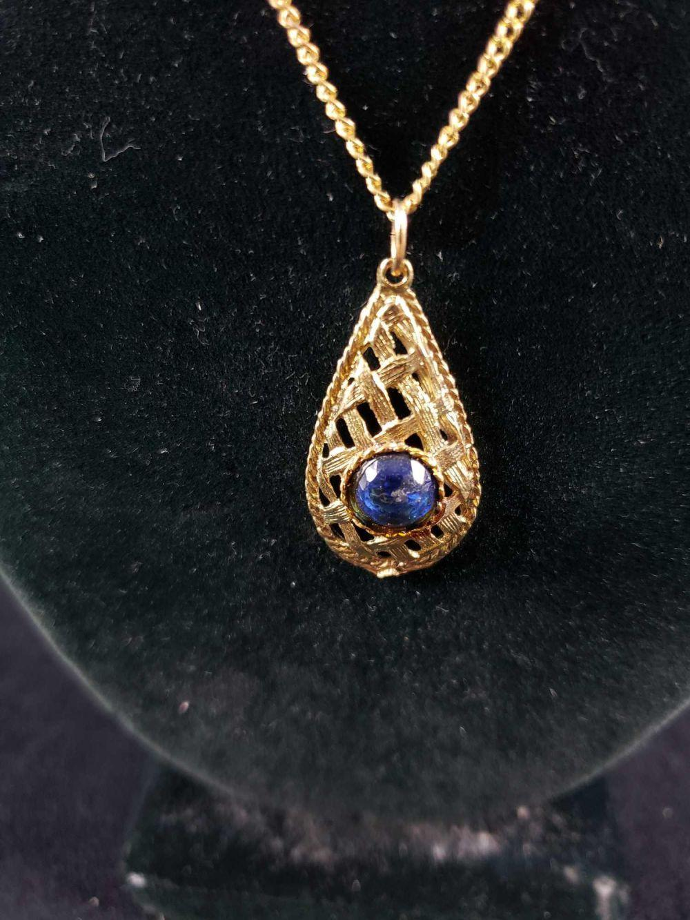 Lot 154: Gold Colored and Faux Sapphire Pendant Necklace
