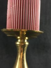 Lot 63: Three Brass Candlesticks and Candles