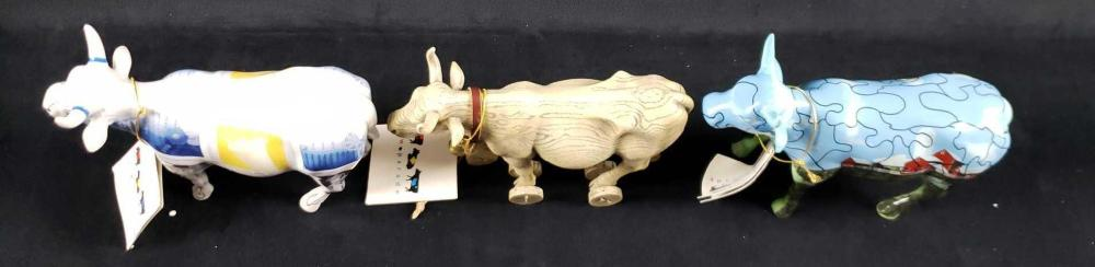 Lot 93: Lot of 3 Toy and Computer Cow Figurines