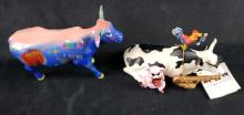Lot 96: Lot of 2 Cow Parade Figurines Big Apple and Mixed Plate Blues
