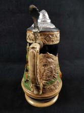Lot 327: German Musical Beer Stein with 3 Dancing People and 3 Dogs