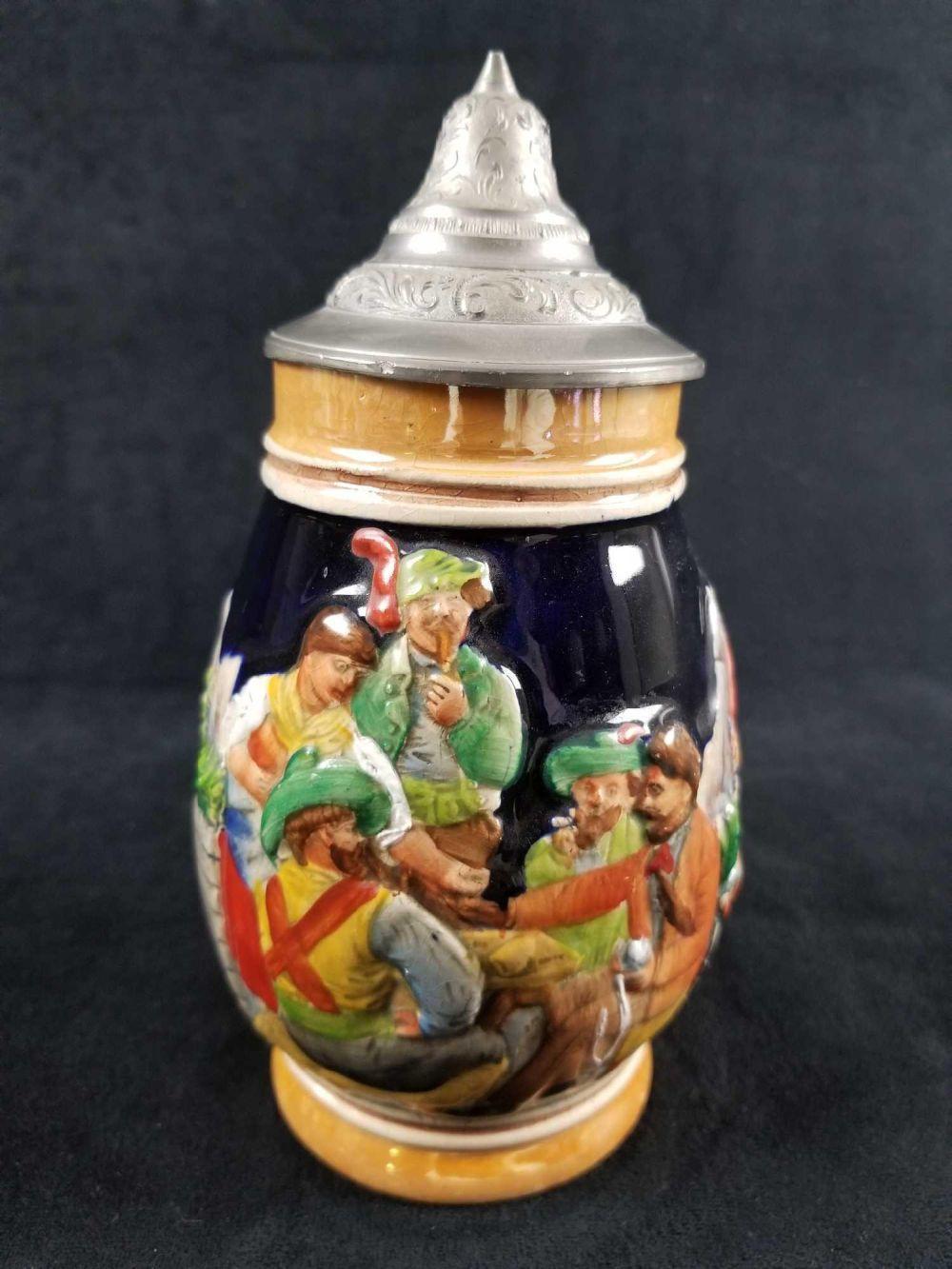Lot 328: Vintage German Beer Stein with Pewter LId featuring Gambling Men