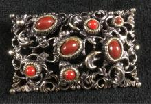Lot 388: Silver Toned Filigree Brooch With Red Stones
