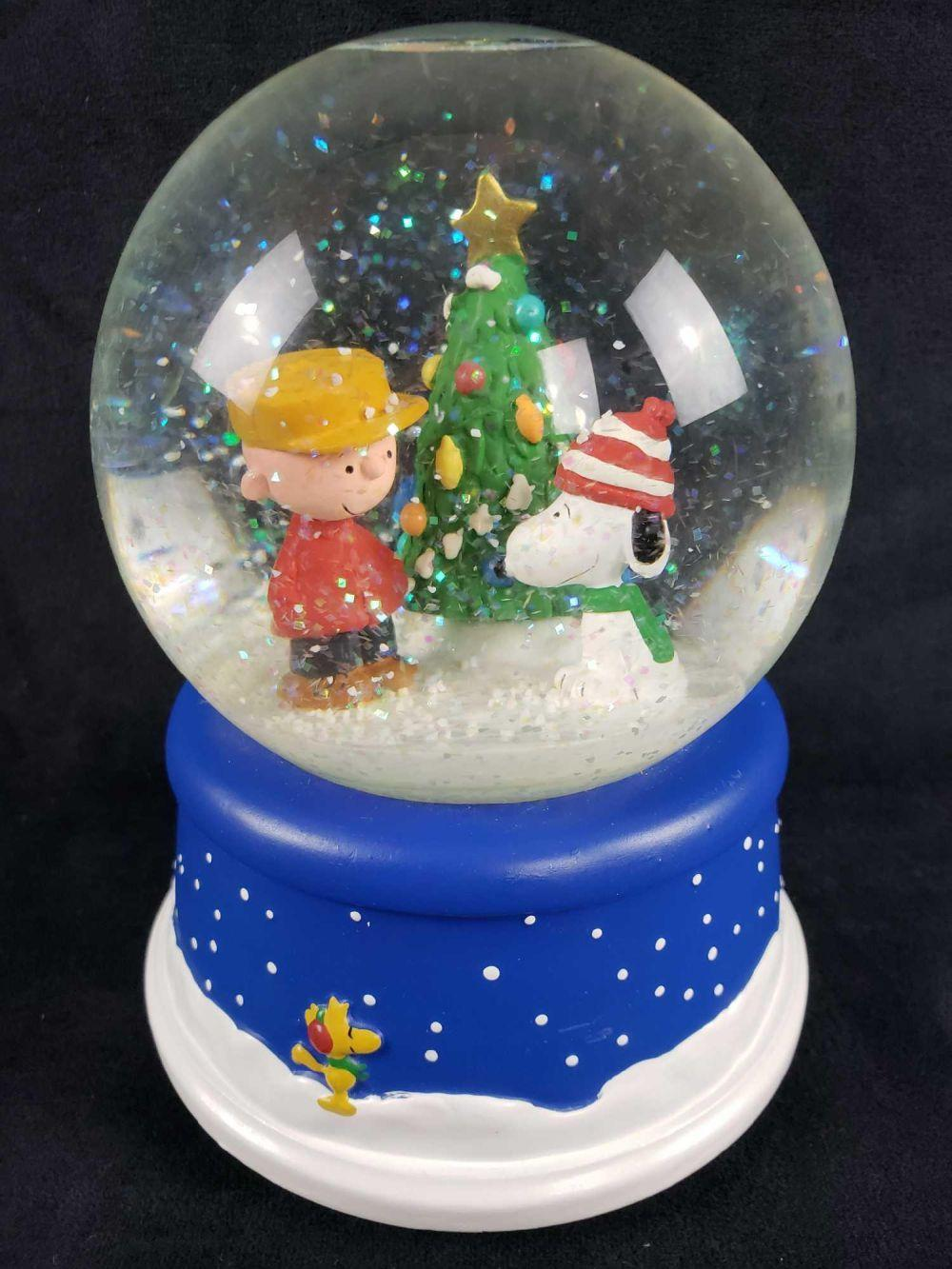 Lot 409: Peanuts Musical Snow Globe by Katrina Bricker