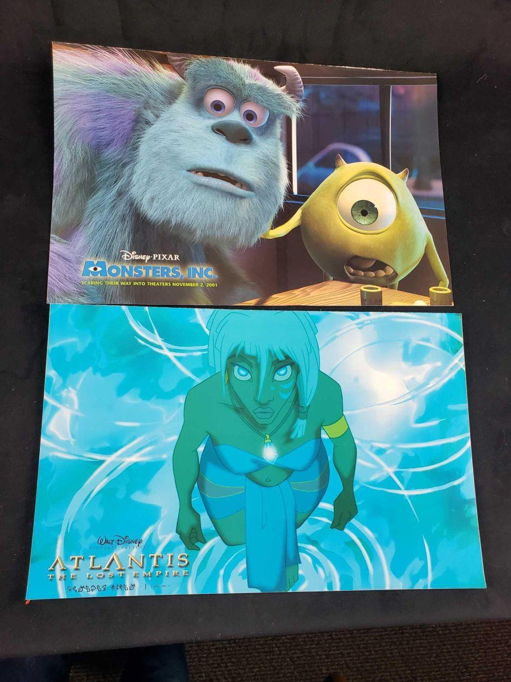Lot 472: Disney Cast Paper Magazines Atlantis and Monsters Inc