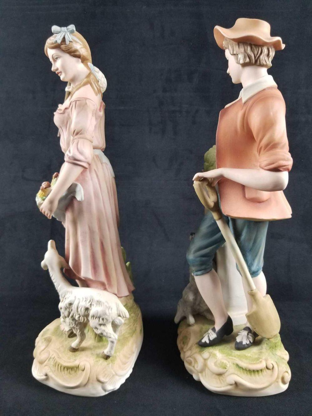 Lot 709: Andrea By Sadek Girl With Lamb And Boy With Dog Porcelain Figurines