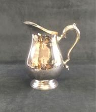 Lot 770: WM Rogers Silver Plated Pitcher
