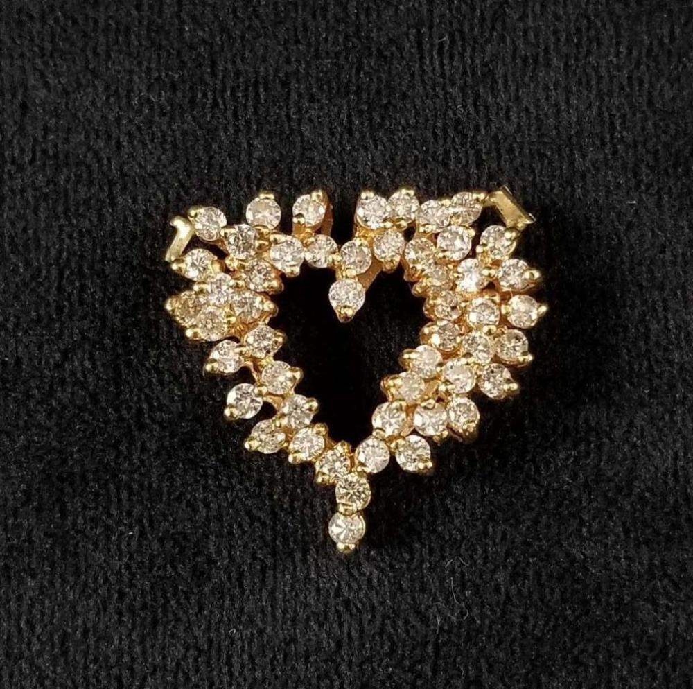 Lot 848: 14K Gold Diamond Heart Pendent