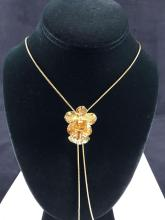 Lot 519: Risis Golds Toned Orchid Slider Necklace