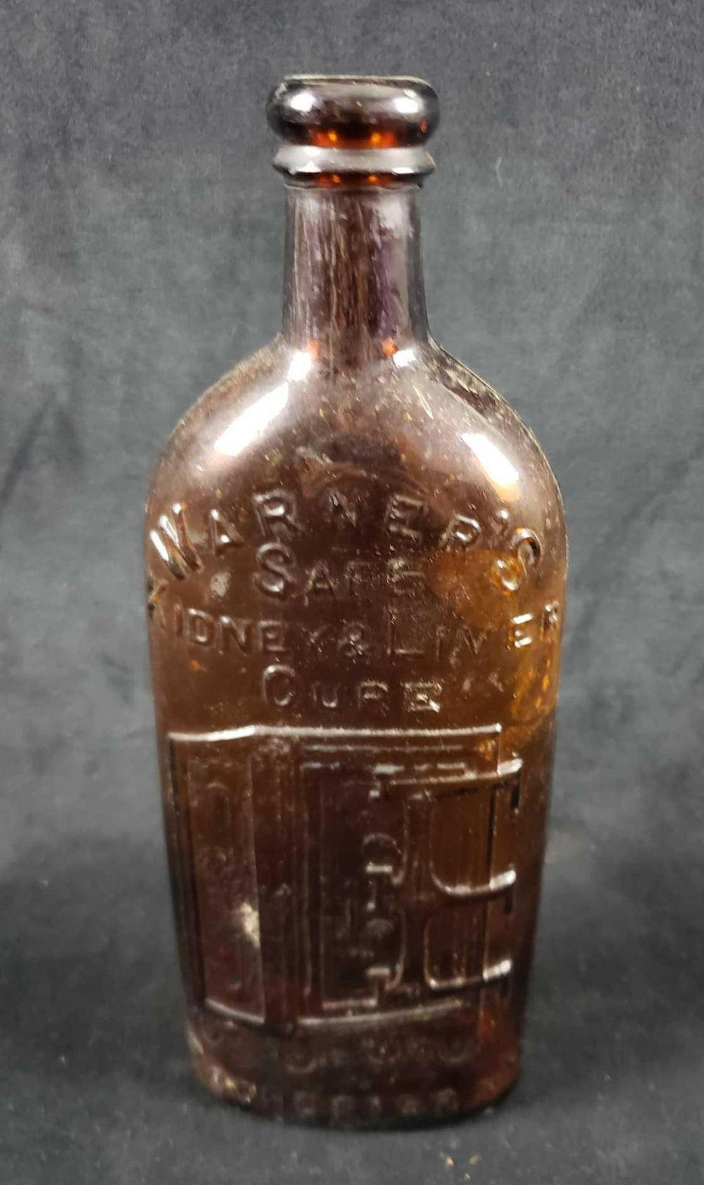 Lot 524: Antique Warners Safe Liver and Kidney Cure Rochester NY Amber Bottle
