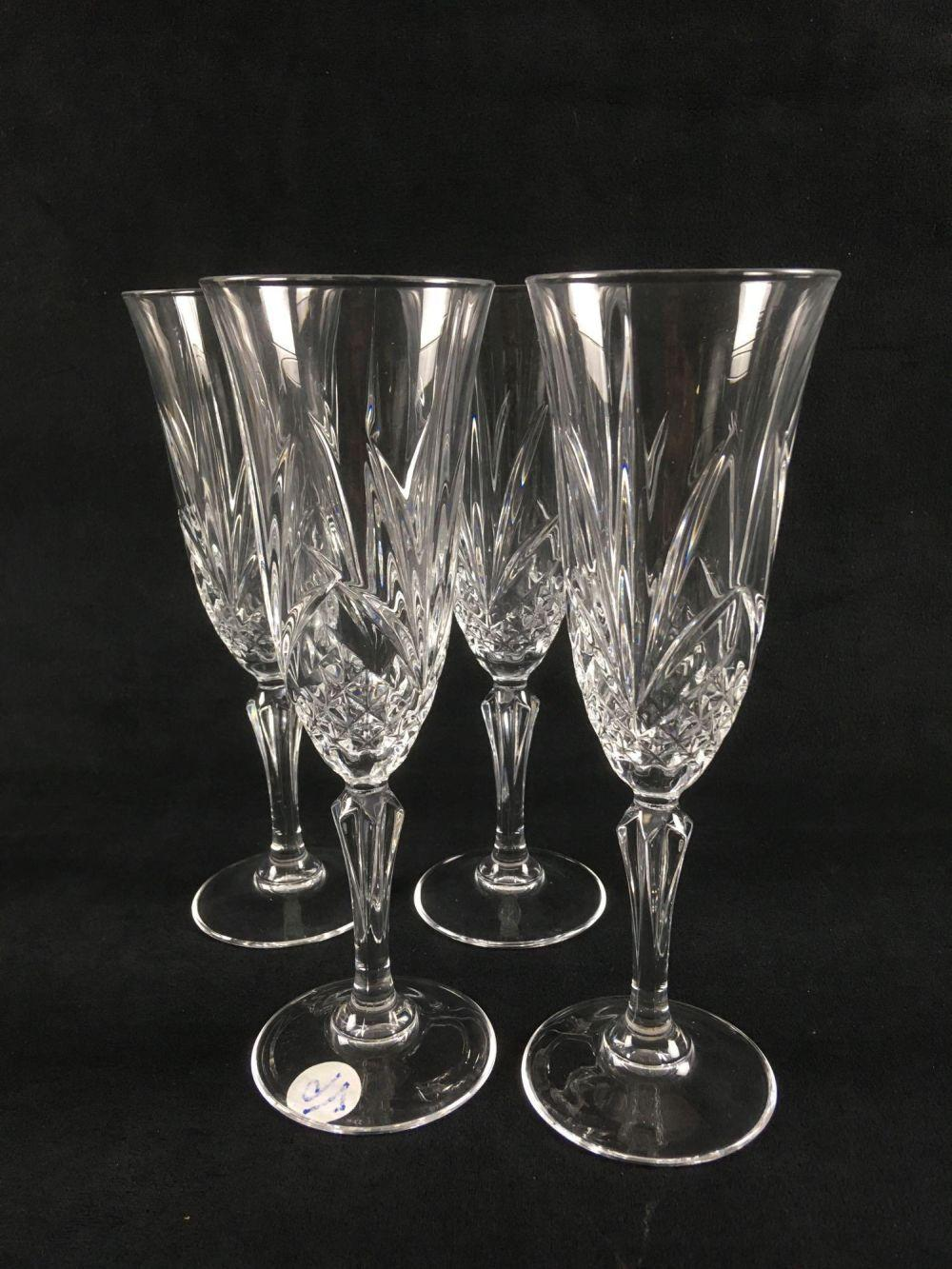 Lot 559: Set of 4 Clear Cut Crystal Champagne Flutes