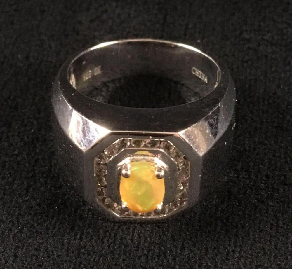 Lot 575: Sterling Silver Ring with Fake Opal Gem