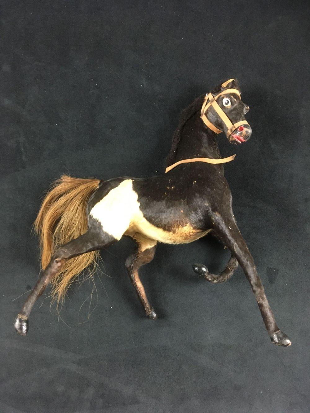 Lot 581: Pair of Vintage German Toy Horses One Steha with Original Packaging and One Covered in Calf Skin