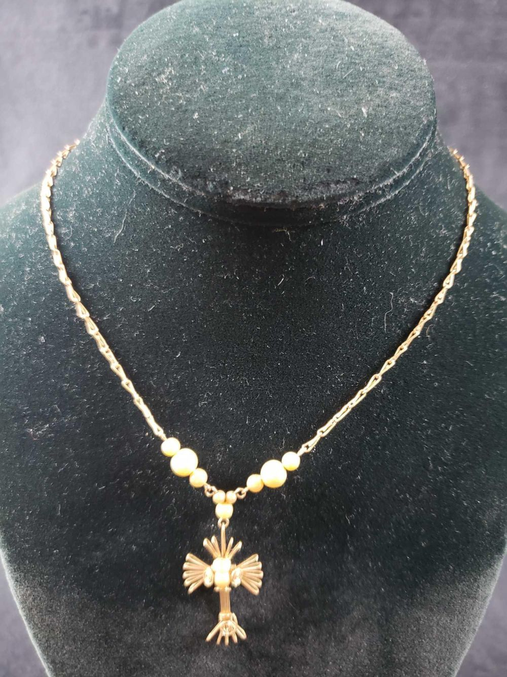Lot 1020: Gold Colored Crucifix Necklace with Faux Pearls Lot 1
