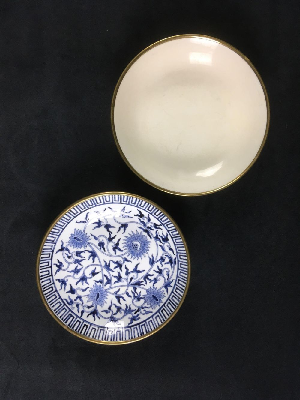 Lot 927: Pair of Vintage Overjoy Hand Painted in Hong Kong Plates with Brass Exterior Overlay