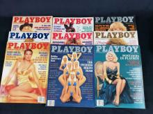 Lot 938: Nine 1992 Playboy Magazines
