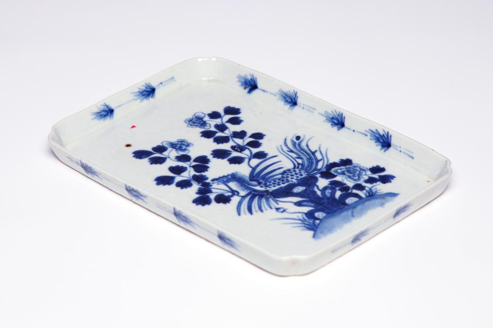 A Blue and white porcelain rectangular teapot tray painted with a phoenix among blooming peonies