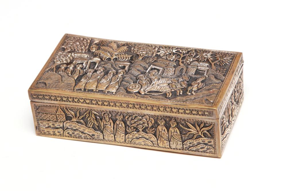 A carved and repousse' rectangular silver box decorated in relief withnobleman