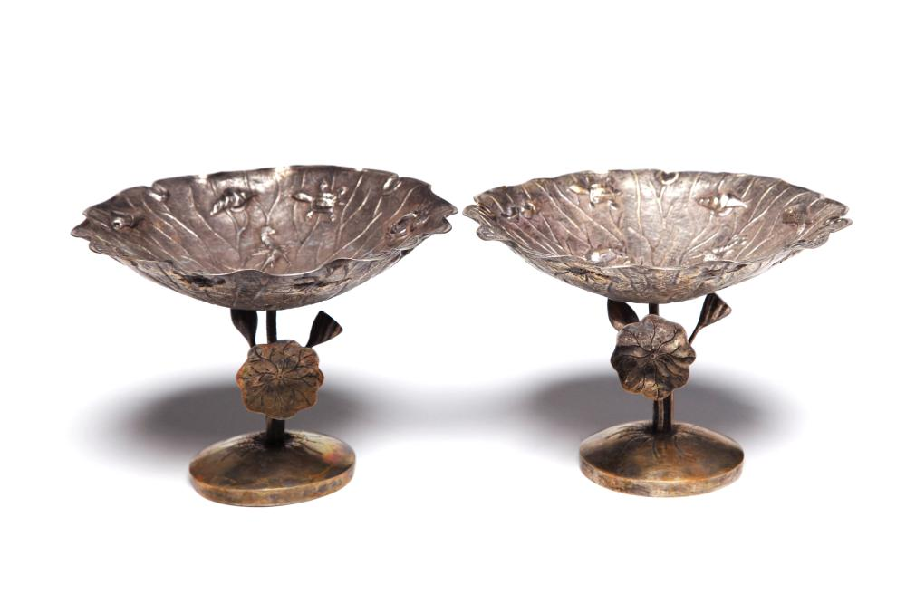 A carved and repousse' silver stem trays in the form of lotus ponds