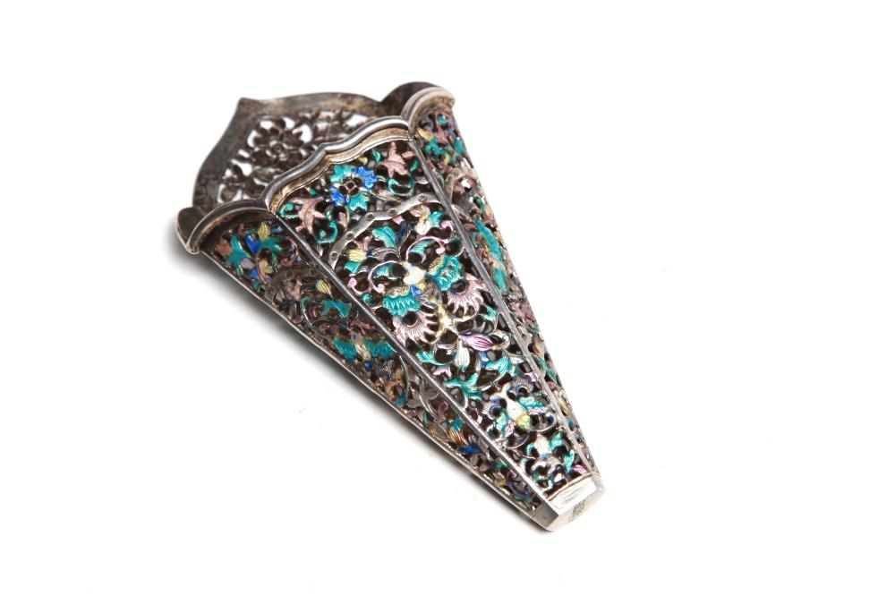 A carved and repousse' silver enameled betel leaf holder with openwork designof butterflies and floral vine scrolls