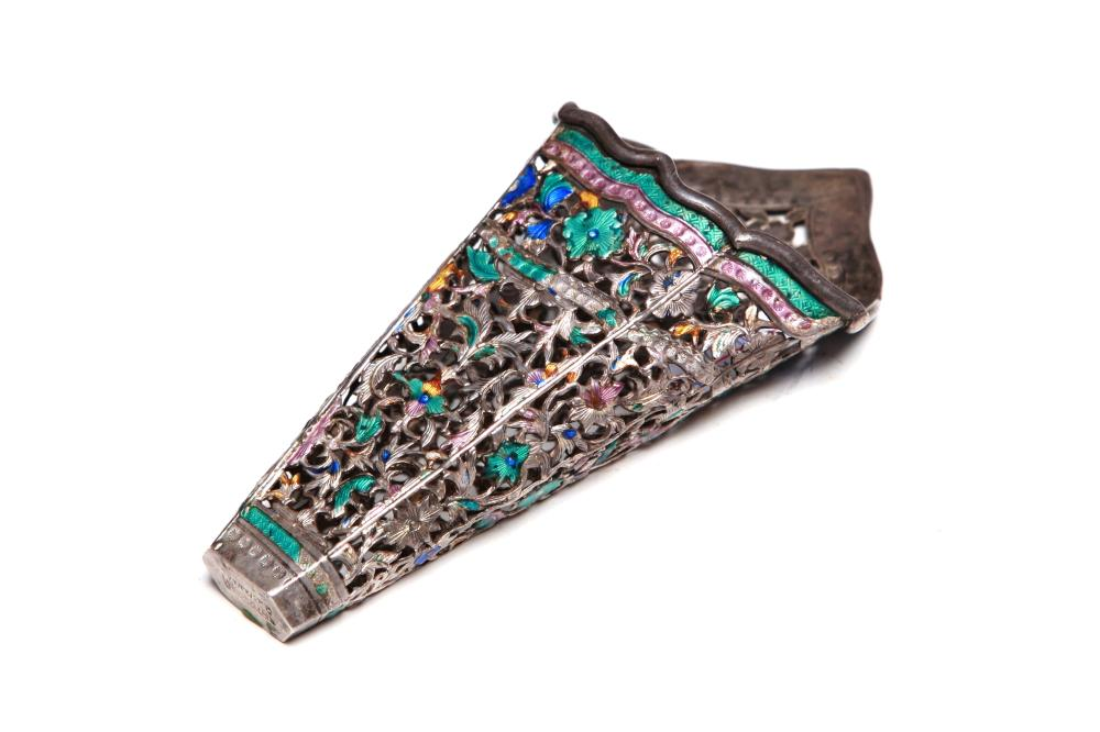 A carved and repousse' silver enameled betel leaf holder with openwork designof floral vine scrolls