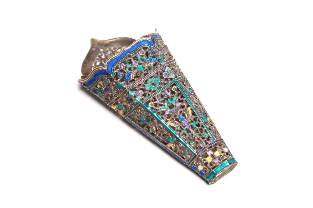 A carved and repousse' silver enameled betel leaf holder with openwork design ofa butterfly and floral vine scrolls