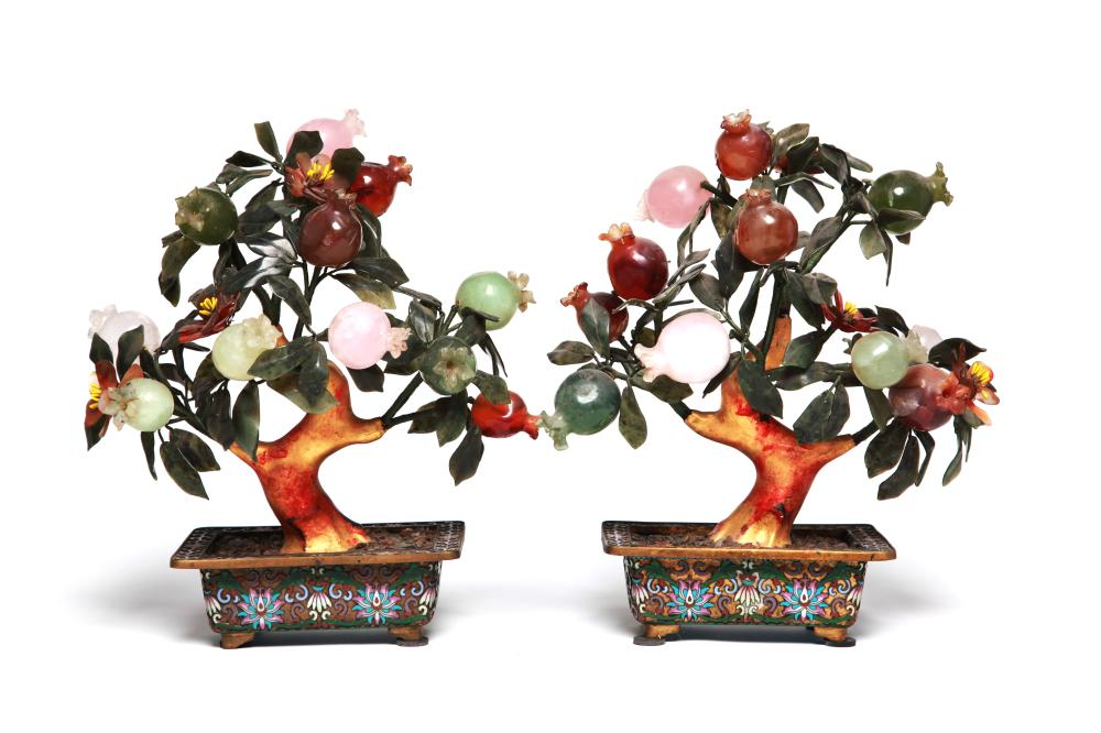 A pair of precious stonetrees with a planter decorated with scrolling lotus design