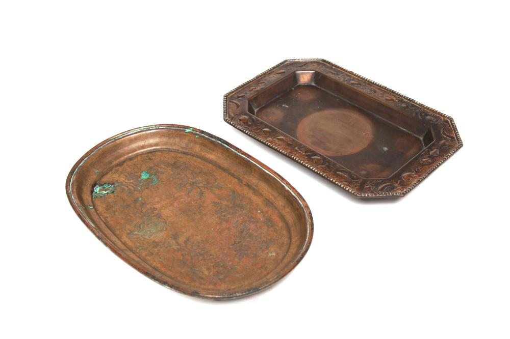 A brass rectangular tray and brass oval tray decorated with floral vine scrolls
